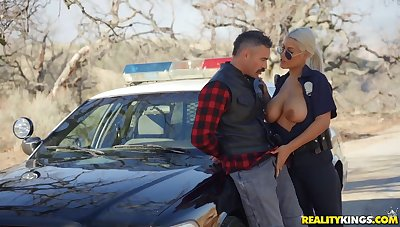 Busty female cop treats herself with a big dick