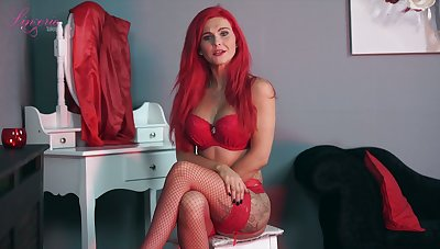 Sexually charged red haired cookie Roxi K tells erotic stories in sexy lingerie