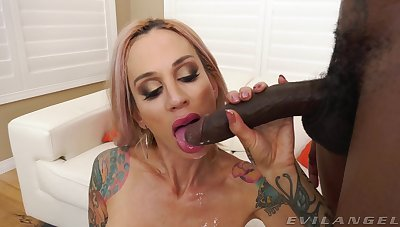 Tow-headed pornstar Sarah Jessie spreads her long legs for anal sex