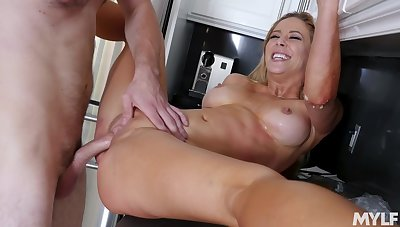 Peaches wife Cherie Deville thither the perfect piecing together fucked in the kitchen
