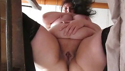 This mature whore has some nice chubby belly and she masturbates like a pro